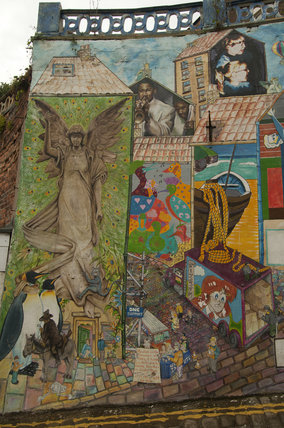 A close up view of the Blands Cliff Murals on brick wall on Blands Cliff