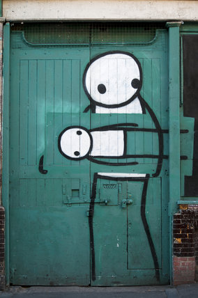 Graffiti in East London by STIK on Pitfield Street
