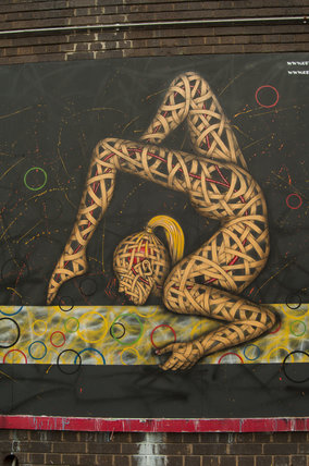 Graffiti in East London of Olympic gymnast by Otto Schad
