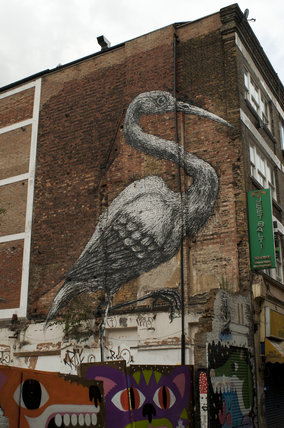 Graffiti in East London of crane by Roa
