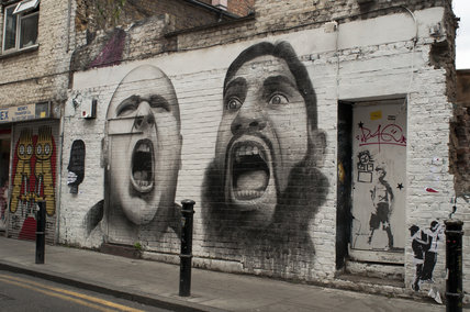 Graffiti in East London called Les Extremes Se Touchent by Ben Slow
