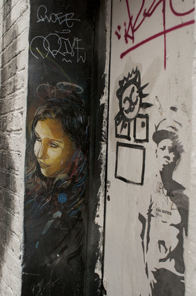 Graffiti in East London of girl by C215