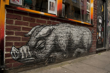 Graffiti in East London of large scale pig by Roa