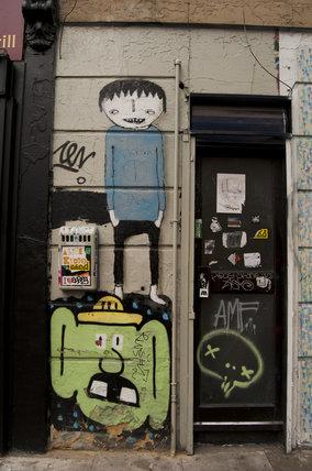 Graffiti in East London on doorway on Bacon Street
