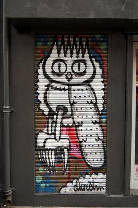 Graffiti in East London of owl by Dscreet on corrugated shutters