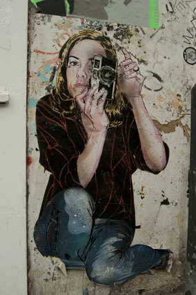Graffiti in East London by Jana & JS of girl taking a photograph