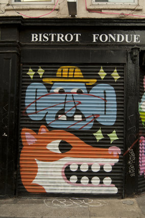 Graffiti in East London by Malarky of a humorous face and fox