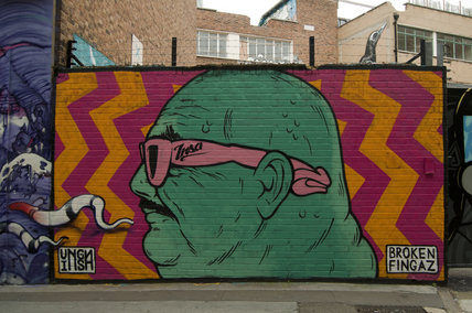 Graffiti in East London of portrait by Broken Fingaz Crew
