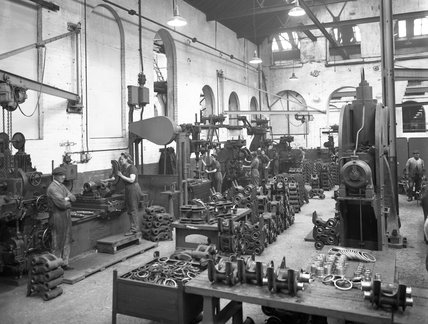 Works photographic negative showing male and female employees in the Bogie Suspension Department, 1943.