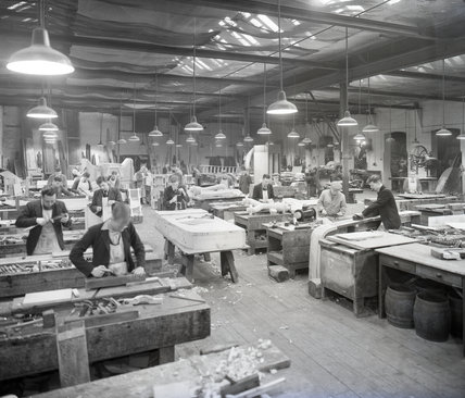 Works photographic negative of interior view of pattern shop with employees, 1950.