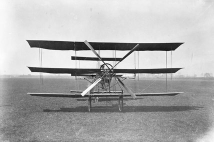 A V Roe in a Roe triplane at Lea Marshes, 1909.