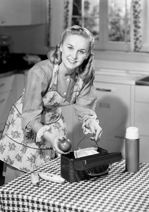Woman packing a lunch box, 1953.