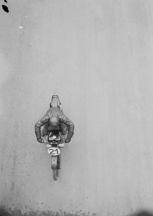 Aerial view of motorcycle no. 21. Photographed by Zoltan Glass, c.1930.