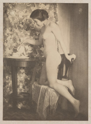 Naked woman pouring tea, 1911