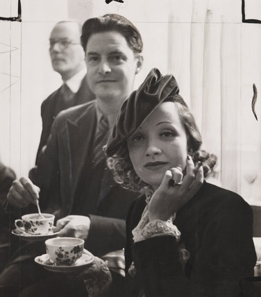 Marlene Dietrich having tea with Robert Donat, 1936