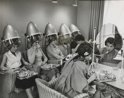 Enjoying tea and a light luncheon at the hairdressers, 1957