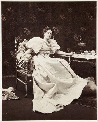 Seated woman drinking tea