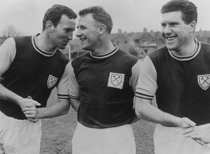 Tommy Docherty and Chelsea Coach Dave Sexton relax in the West Ham strip after a charity game, 1963
