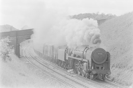 A steam locomotive hauling a goods train, passing under bridge,A1969.70/Box 5/Neg 1235/28