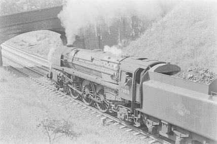 A steam locomotive approaching a bridge. Locomotive number: 70010,A1969.70/Box 5/Neg 1236/27