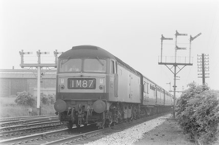 A diesel locomotive pulling a passenger train 1M87,A1969.70/Box 5/Neg 1237/32