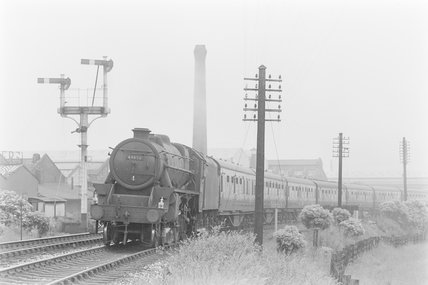 A steam locomotive pulling a passenger train. Locomotive number: 44658,A1969.70/Box 5/Neg 1237/34