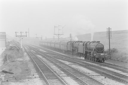 A steam locomotive pulling a passenger train. Locomotive number [44920],A1969.70/Box 5/Neg 1237/35