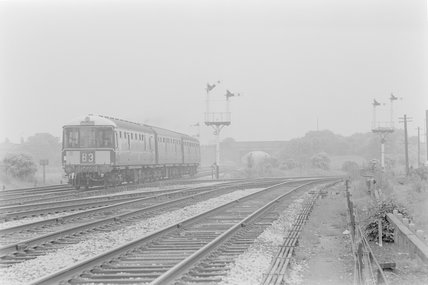 A diesel locomotive pulling a passenger train,A1969.70/Box 5/Neg 1239/24