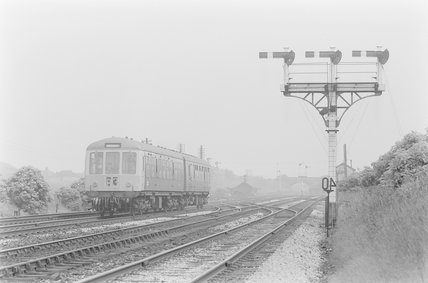 A diesel locomotive pulling a passenger train. Locomotive number: B3,A1969.70/Box 5/Neg 1239/27