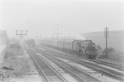 Photographic negative taken by John Clarke of two steam locomotives with trains on parallel track,A1969.70/Box 5/Neg 1239/29