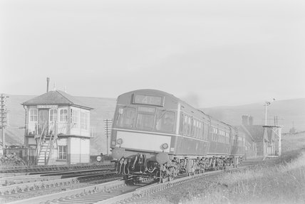 A diesel locomotive pulling a Leeds bound passenger train,A1969.70/Box 5/Neg 1240/13
