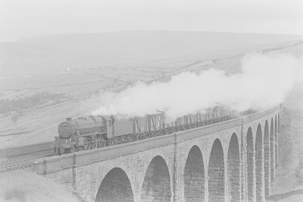 A steam locomotive hauling a goods train on a viaduct,A1969.70/Box 5/Neg 1240/17
