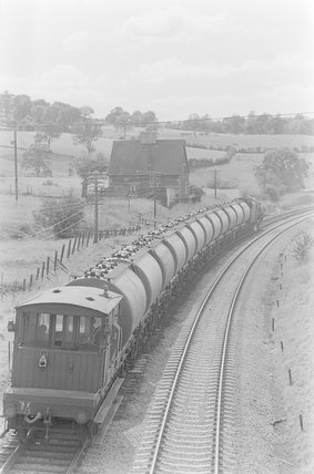 A steam locomotive hauling a goods train, rear view showing the guard's van,A1969.70/Box 5/Neg 1241/32