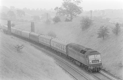 A diesel locomotive pulling a passenger train,A1969.70/Box 5/Neg 1241/34
