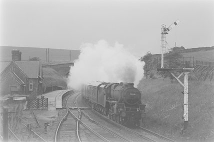 A steam locomotive pulling a passenger train to Skipton, at a station,A1969.70/Box 5/Neg 1242/10