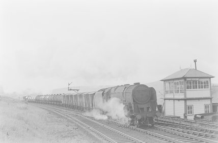 A steam locomotive hauling a goods train, passing a signal box,A1969.70/Box 5/Neg 1243/24