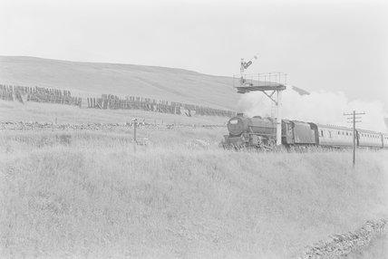 A steam locomotive pulling a passenger train,A1969.70/Box 5/Neg 1243/26