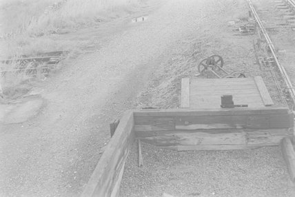 A wooden gravel pit and two sets of wheels on axles,A1969.70/Box 5/Neg 1243/27
