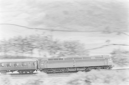 A diesel locomotive pulling a passenger train,A1969.70/Box 5/Neg 1244/12