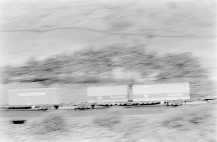 Photographic negative taken by John Clarke of goods wagons at high speed,A1969.70/Box 5/Neg 1246/16