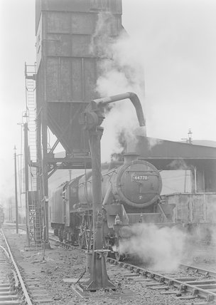 A steam locomotive taking on water,A1969.70/Box 5/Neg 1246/20