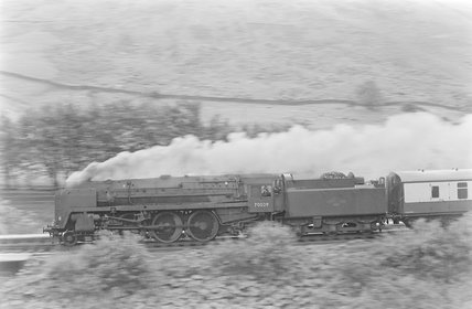 A steam locomotive pulling a passenger train,A1969.70/Box 5/Neg 1246/21