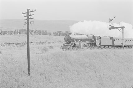 A steam locomotive pulling a passenger train,A1969.70/Box 5/Neg 1247/28