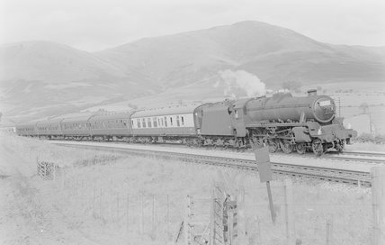 A steam locomotive pulling a passenger train,A1969.70/Box 5/Neg 1247/31