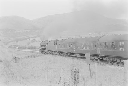 A steam locomotive pulling a passenger train,A1969.70/Box 5/Neg 1247/33