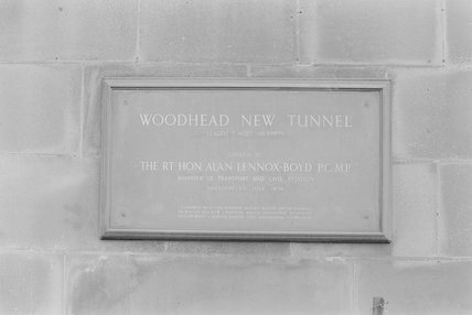 A metal wall plaque commemorating a tunnel opening,A1969.70/Box 5/Neg 1248/5