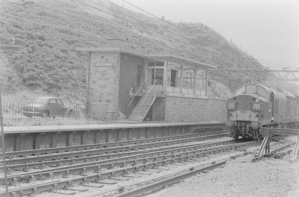 A diesel locomotive at a station,A1969.70/Box 5/Neg 1248/7