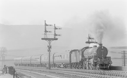 A steam locomotive pulling a passenger train,A1969.70/Box 5/Neg 1250/17