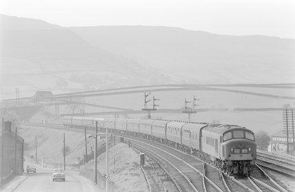 A diesel locomotive pulling a passenger train,A1969.70/Box 5/Neg 1250/18
