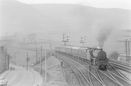 A steam locomotive pulling a passenger train,A1969.70/Box 5/Neg 1250/20
